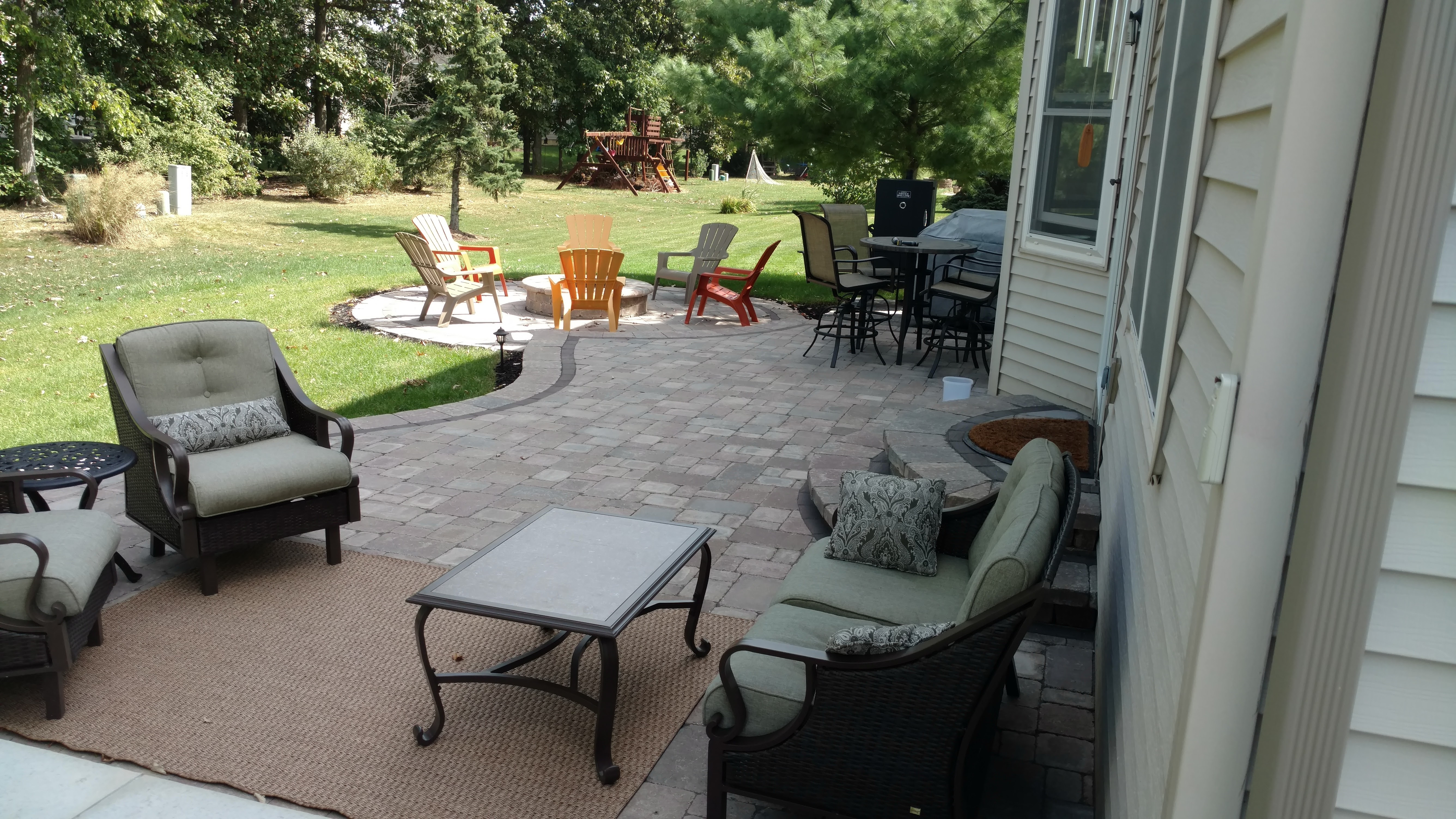 The Project Features A Multi Tiered Paver Patio With A Privacy Wall And  Custom Fire Pit. True To The Title Of This Focus Story, This Backyard Oasis  Has All ...