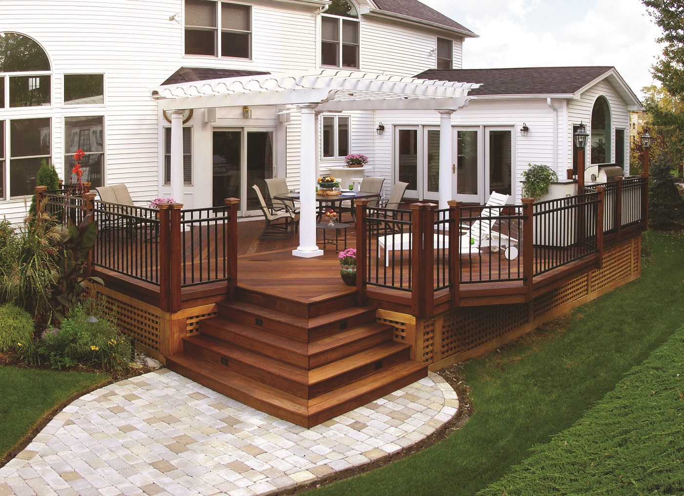 Wooden-freestanding-deck-with-pergola-and-paver-patio-below