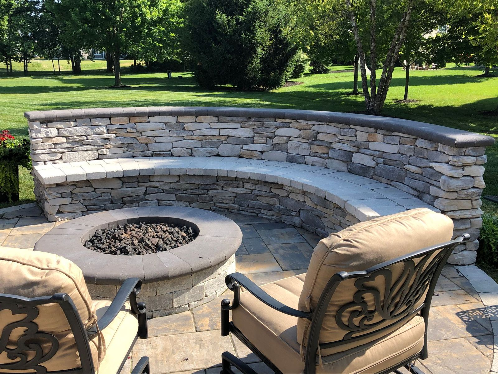 Fire-pit-with-seating-wall-and-bench